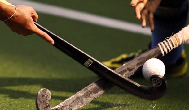 Dribbling through challenges with hockey sticks
